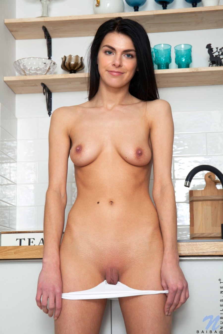 Shaved pussy on a young brunette