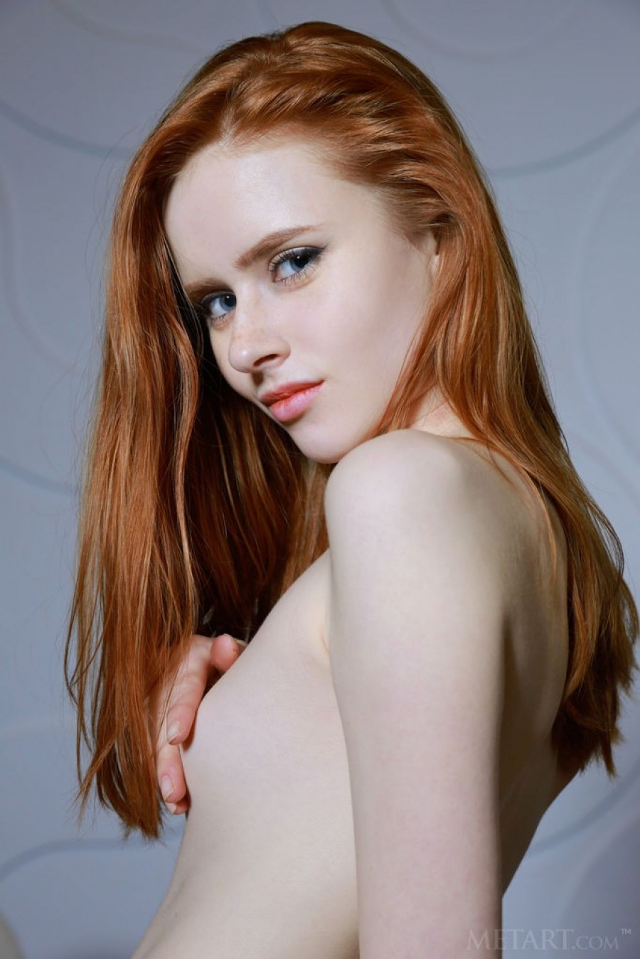 Redhead sweetie likes to pose