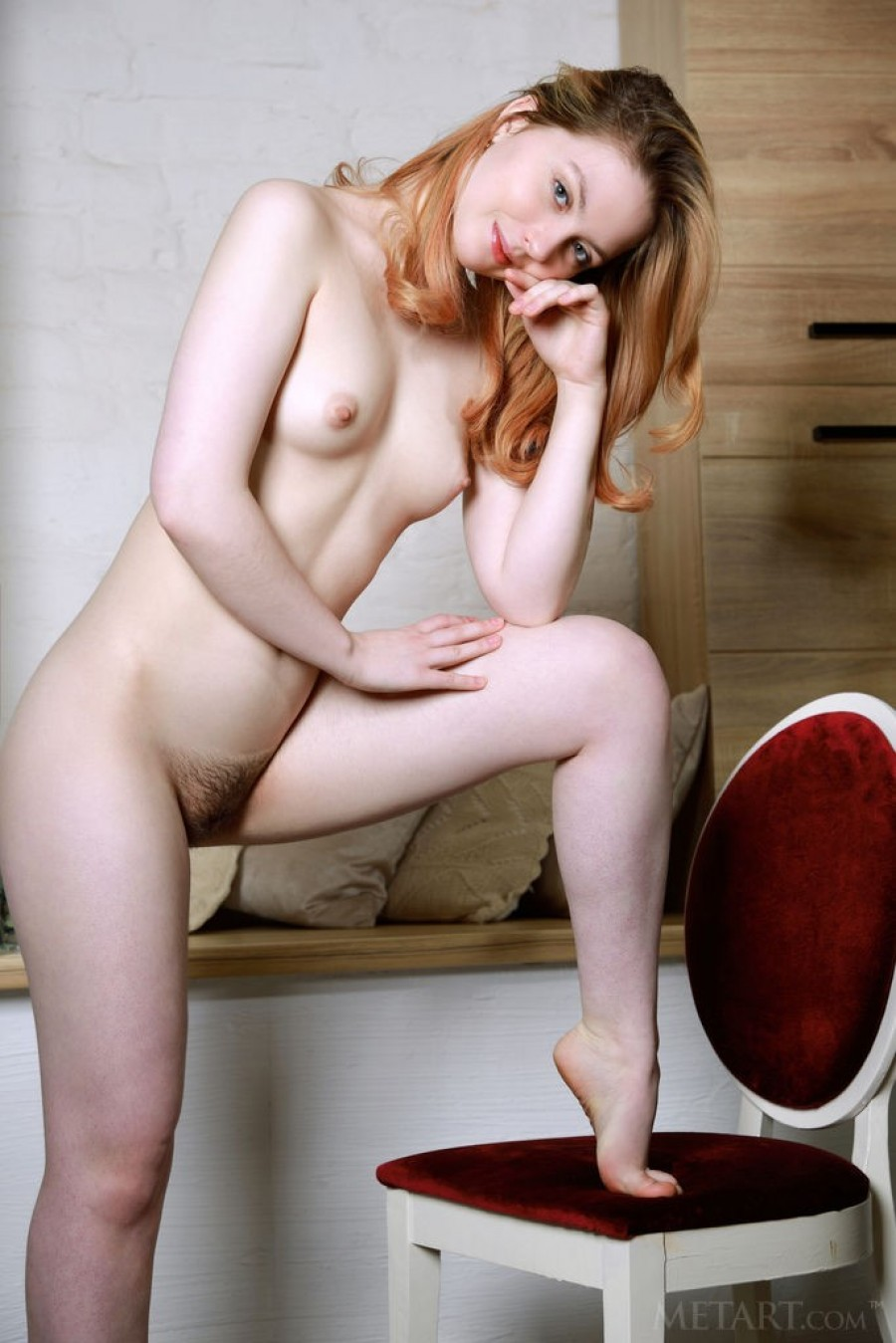 Horny redhead playing on her computer