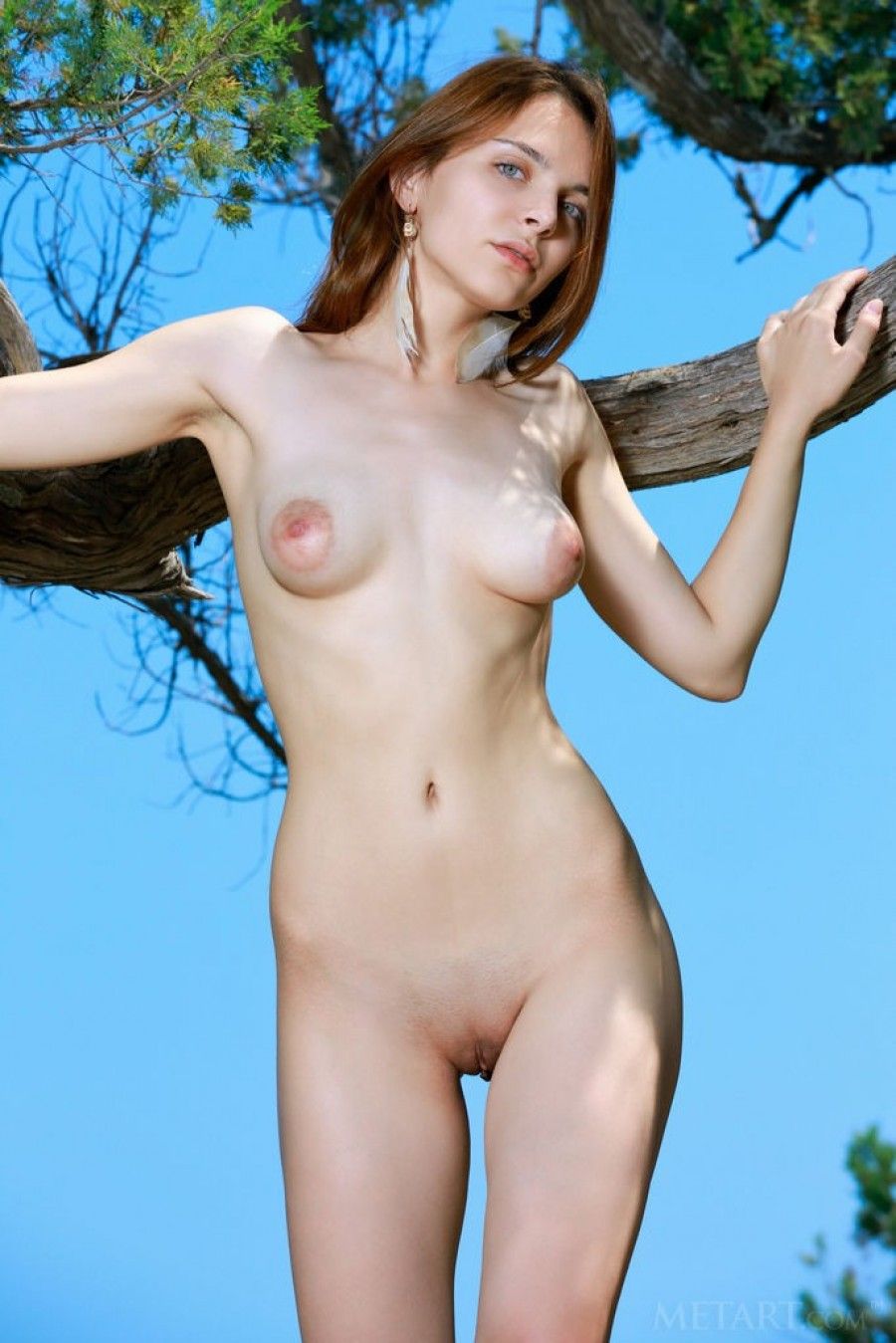 Redhead with puffy nipples outside