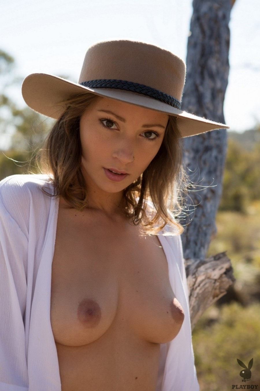 Blonde cowgirl striping outdoors