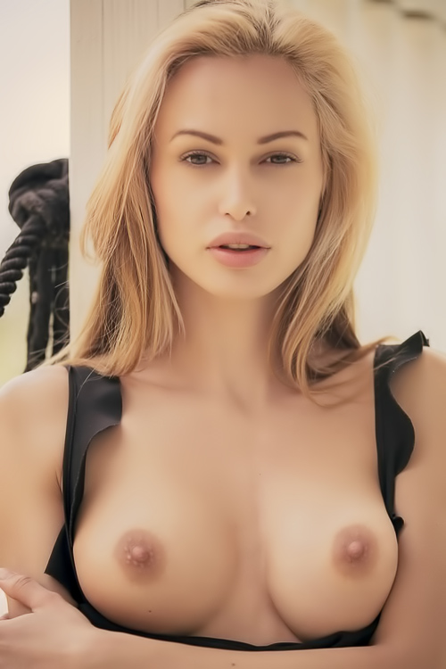 Delicate blonde strip tease