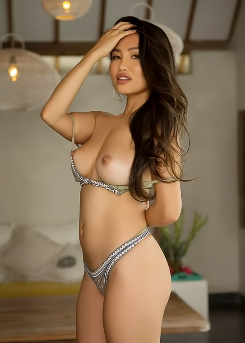 Asian hottie gets naked