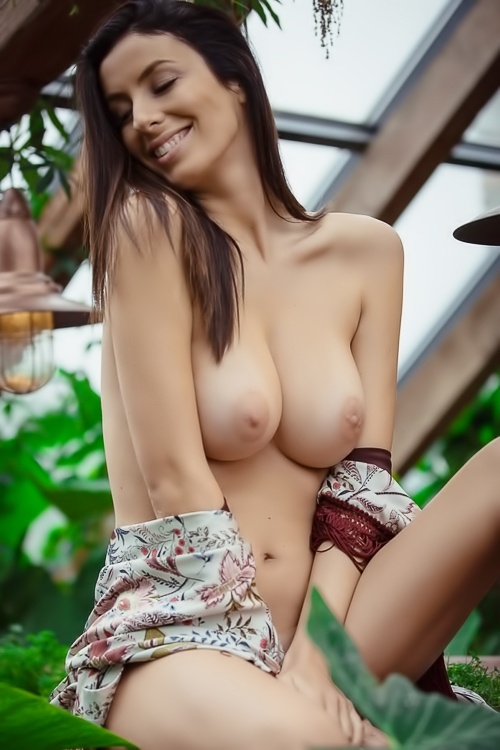 Busty brunette beauty outdoors