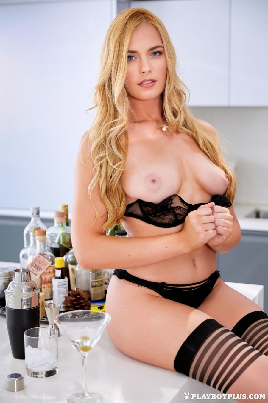 Glamorous MILF in the kitchen
