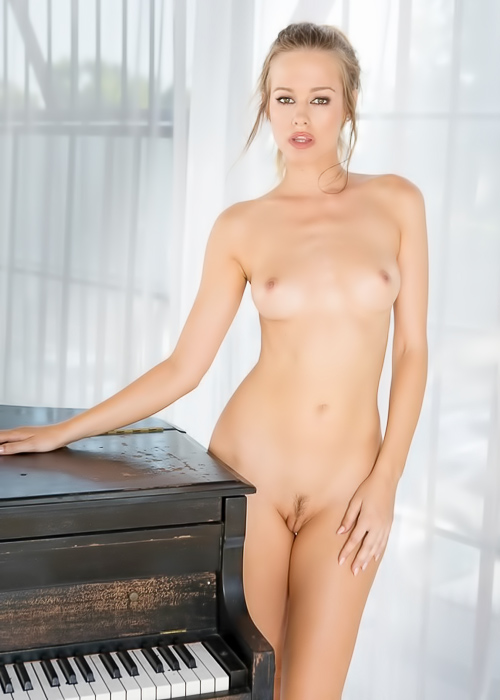 Chick rubs shaved pussy on piano
