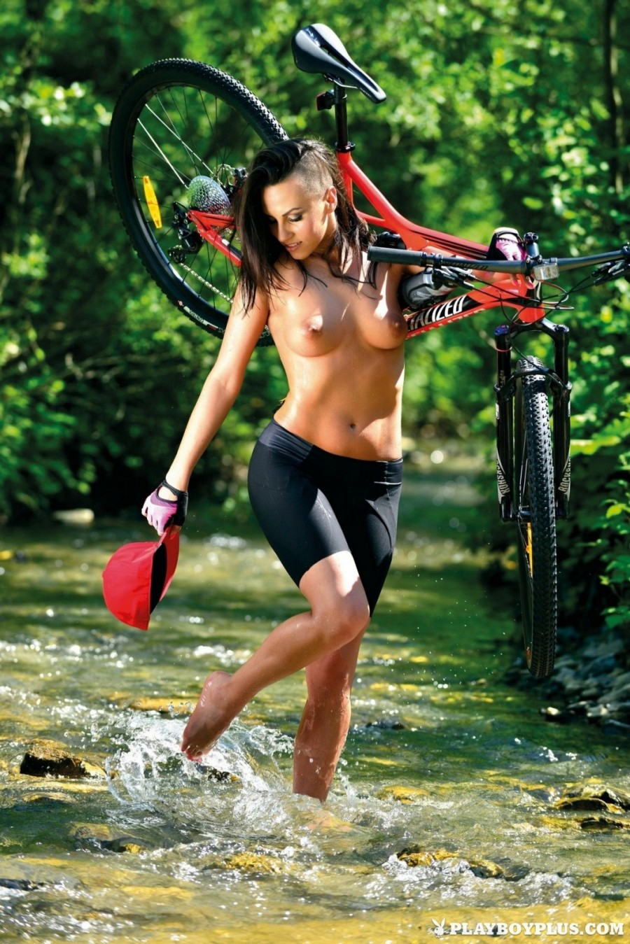 Sporty brunette biking and striping