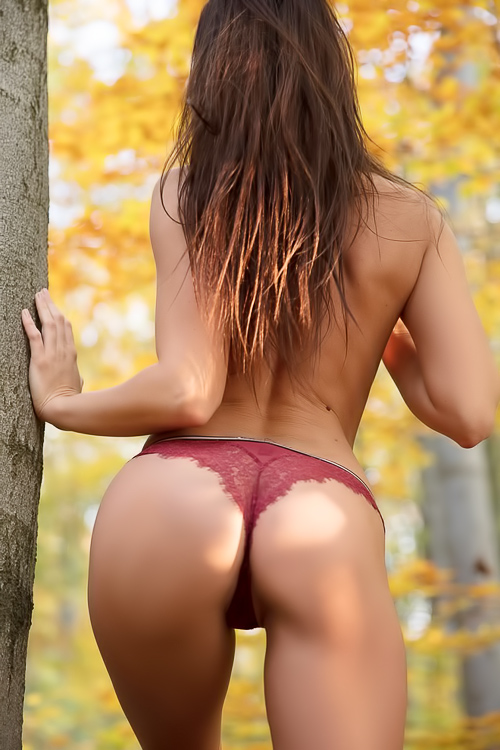 Young brunette is stripping outdoors