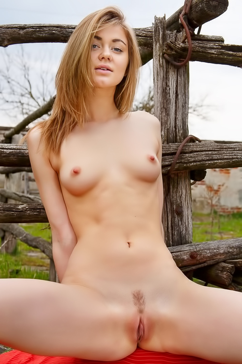 Natural redhead naked in nature