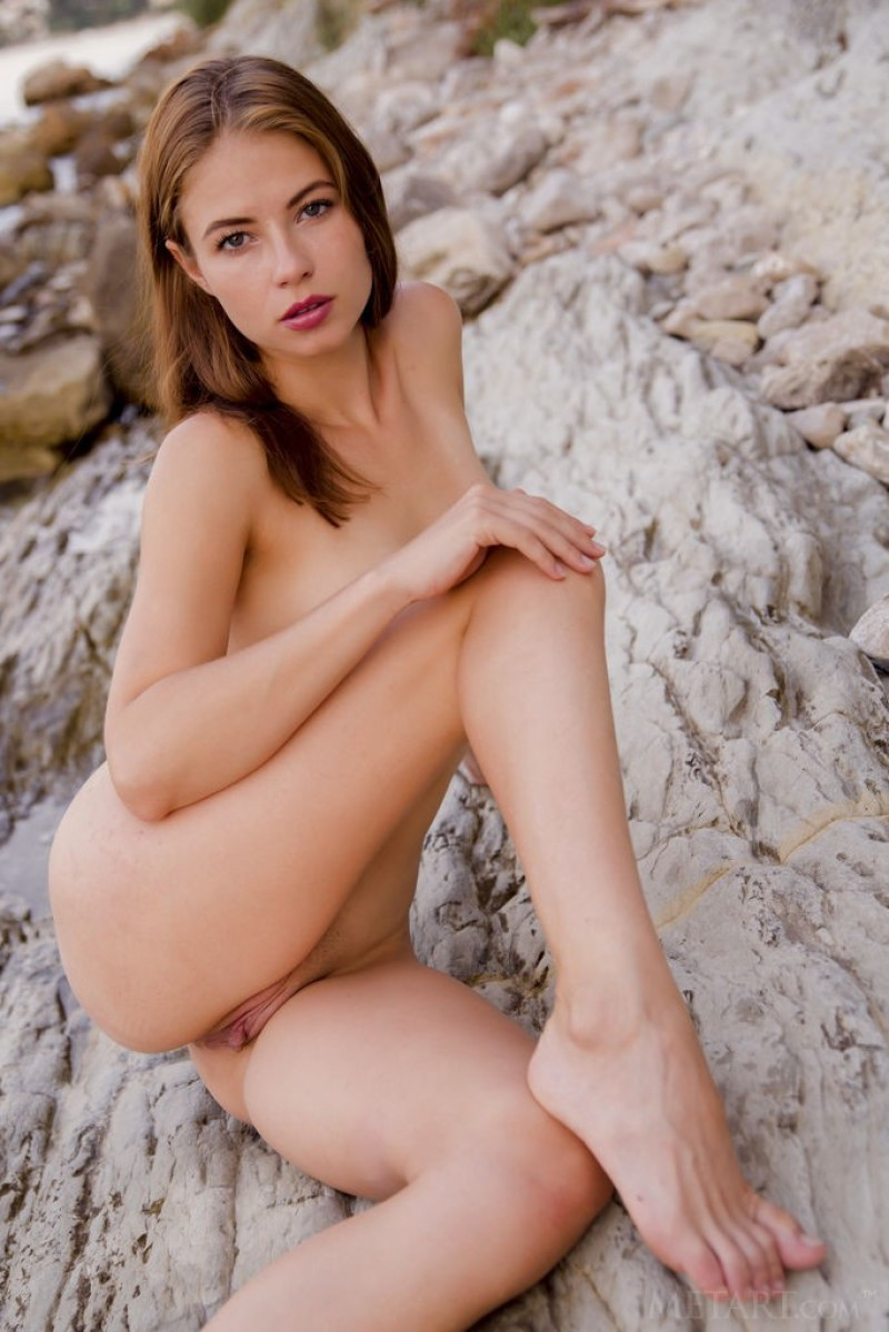 Stunning model gets naked at the beach