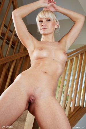 Naked blondie opens shaved pussy on stairs