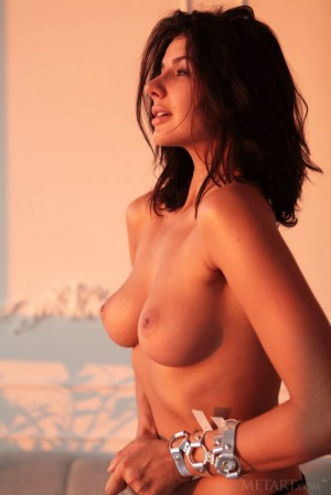 Dark-haired sweetie undresses at the sunset