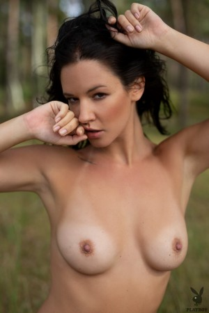 Naked hottie gets a perfect tan in the forest