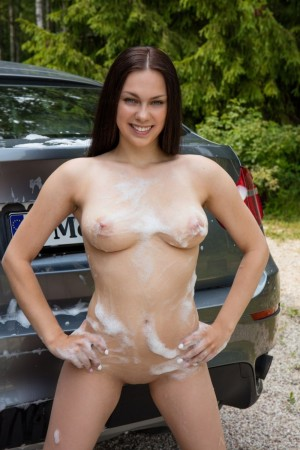 Cutie washes car and her own naked body