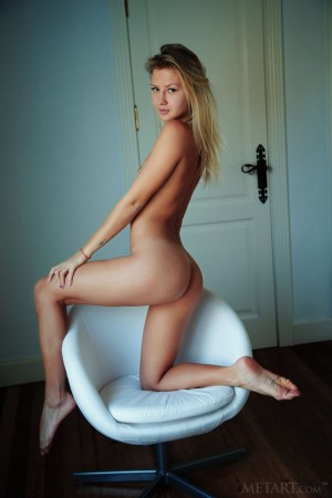 Gorgeous blonde orgasms in her armchair