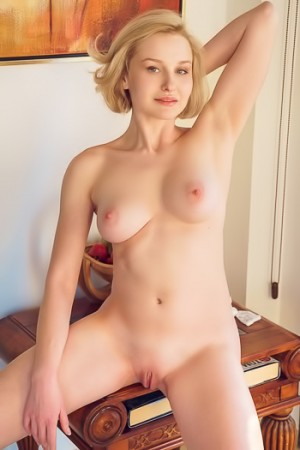 Short haired blonde gives her perky, perfect tits a squeeze