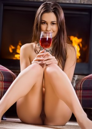 Having a glass of wine while relaxing naked by the fire
