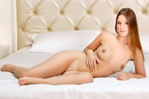 Classy, pretty redhead enjoying time in bed naked