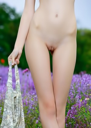 The flowers in the field are not as fine as her nude body