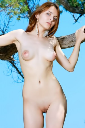 Redhead with blue eyes and puffy nipples naked in public